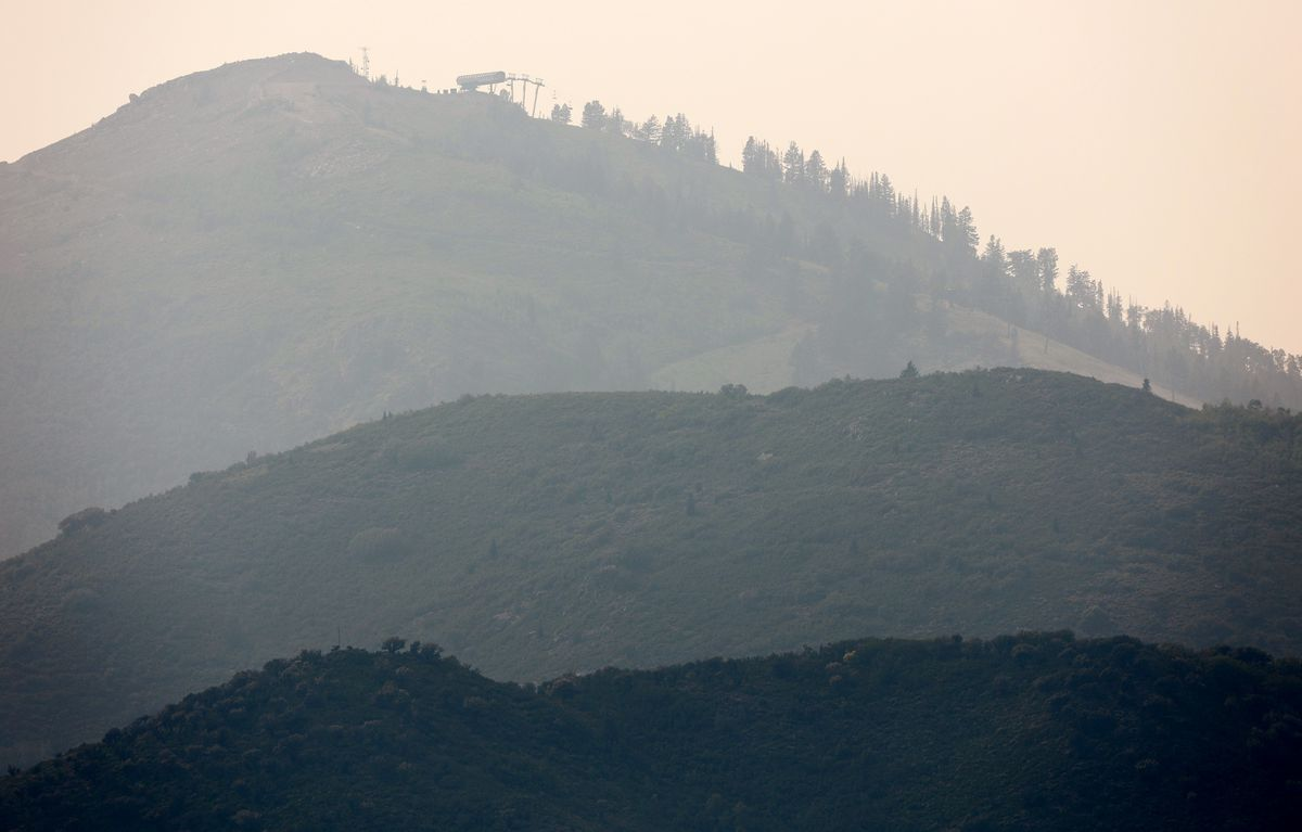 Smoke in the mountains as crews continue fighting the Parley's Canyon Fire near Park City on Sunday, Aug. 15, 2021.