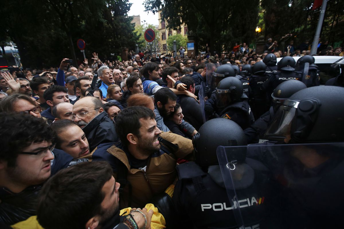 Spanish National Police clash with referendum supporters in Barcelona on Oct. 1, 2017.