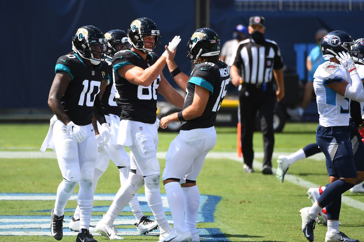Jacksonville Jaguars tight end Tyler Eifert celebrates with Jacksonville Jaguars quarterback Gardner Minshew after a touchdown during the first half against the Tennessee Titans at Nissan Stadium