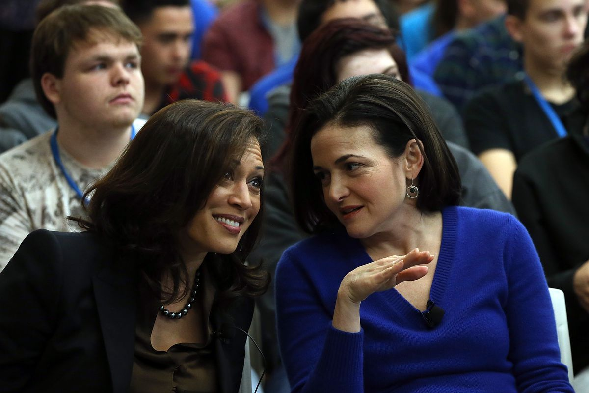 Sen. Kamala Harris (left) smiles as she speaks with Facebook COO Sheryl Sandberg.