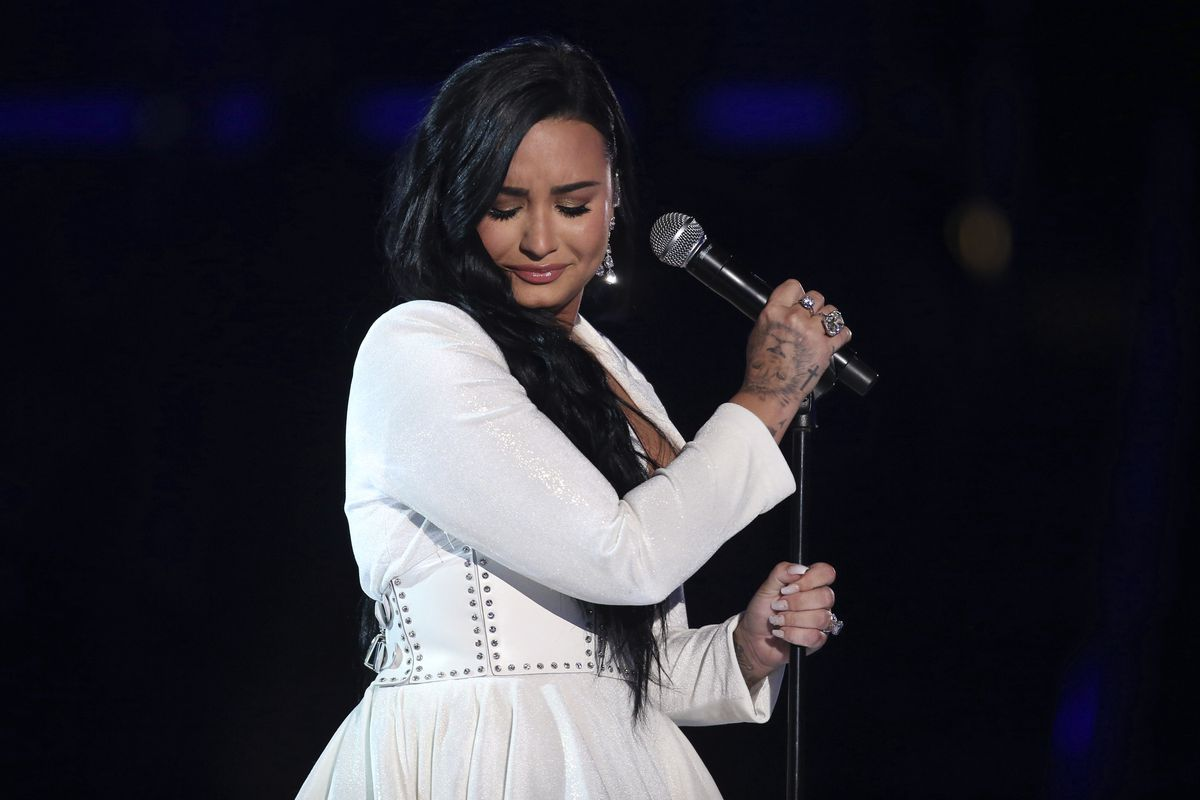 """Demi Lovato performs """"Anyone"""" at the 62nd annual Grammy Awards on Sunday, Jan. 26, 2020, in Los Angeles. The singer has been outspoken about her struggles with mental illness, and hopes to help others through COVID-19 with her new Mental Health Fund."""