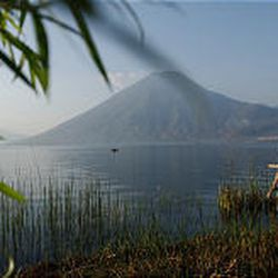 A tourist relaxes at Lake Atitlan, Solola. Just under 1.2 million foreigners visited Guatemala in 2004, nearly 300,000 of whom were Americans. Guatemalan officials hope to surpass 1.4 million visitors this year.