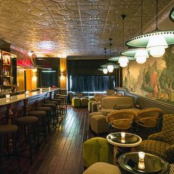 """<a href=""""http://ny.eater.com/archives/2012/05/the_experimental_cocktail_club_now_open_on_the_les.php"""">Inside The Experimental Cocktail Club</a>"""