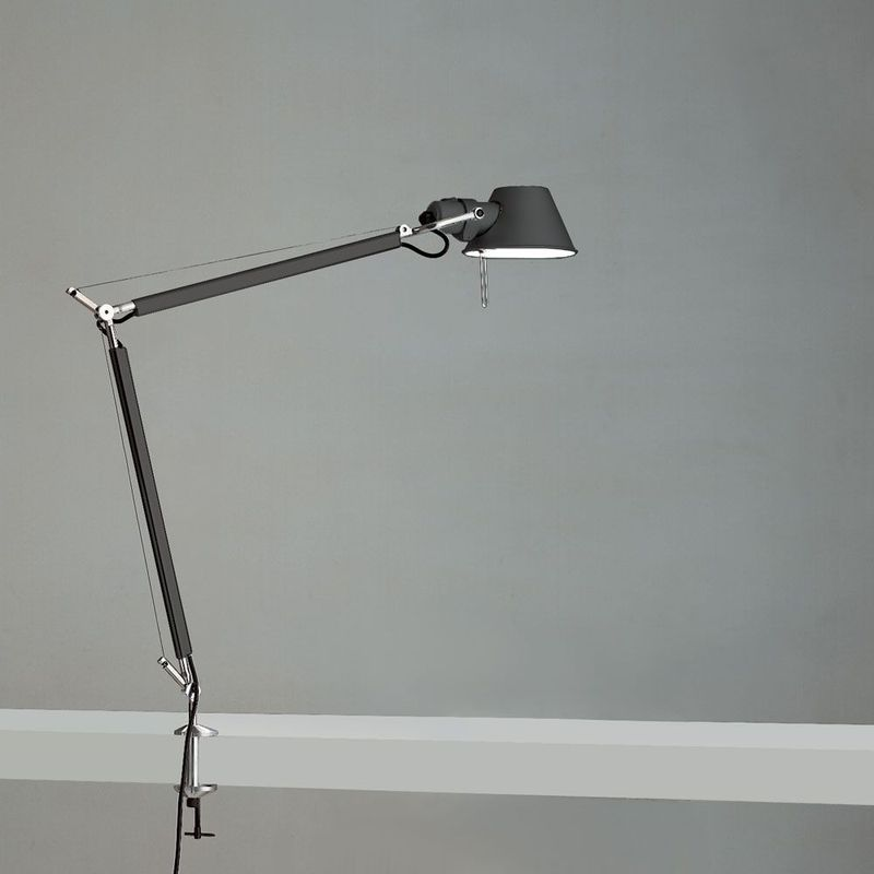 Thin black lamp with bent arm.