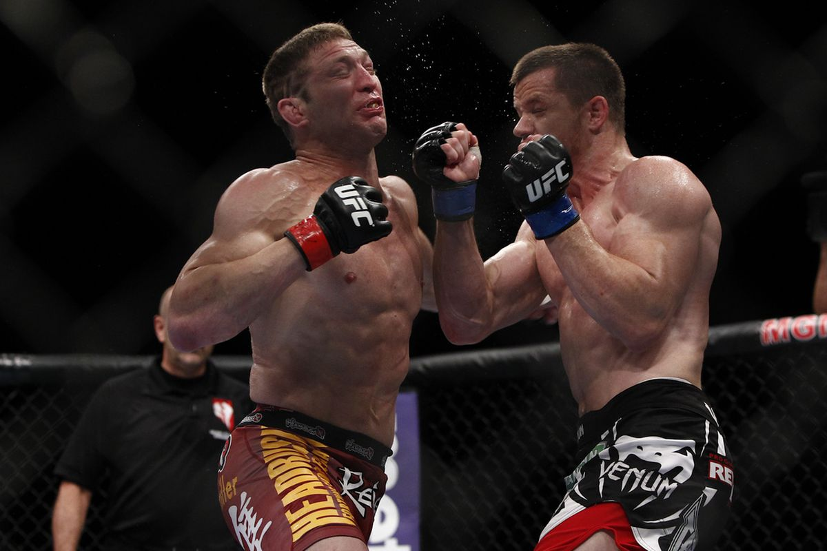 """Jason """"Mayhem"""" Miller takes a punch from C.B. Dollaway at UFC 146. Photo taken by Esther Lin of MMA Fighting."""