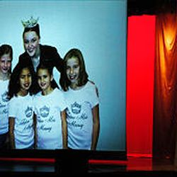 Camille Jensen sings a final song during a slide show featuring pictures from her yearlong reign as Miss Murray.