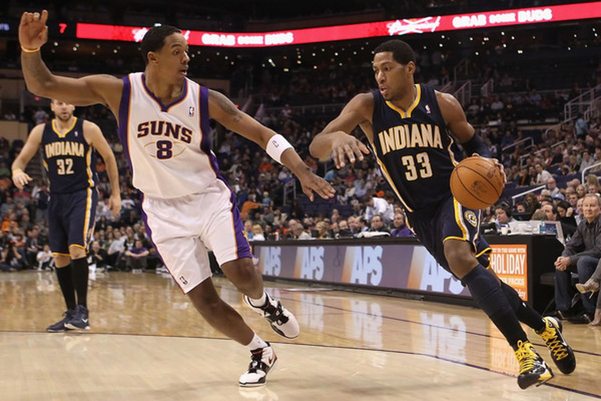 PHOENIX - DECEMBER 03:  Danny Granger #33 of the Indiana Pacers drives the ball against Channing Frye #8 of the Phoenix Suns during the NBA game at US Airways Center on December 3 2010 in Phoenix Arizona.  (Photo by Christian Petersen/Getty Images)