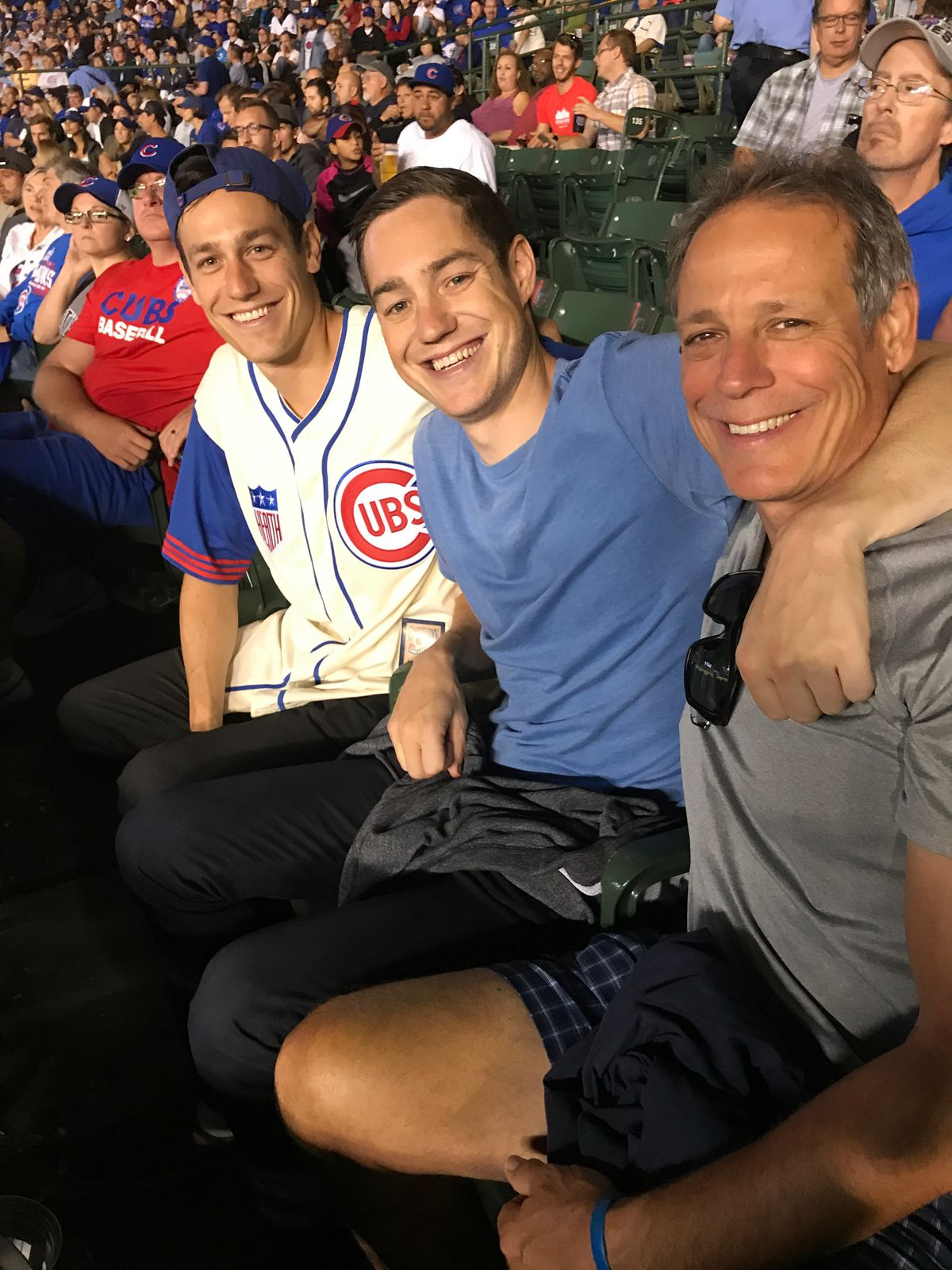 """John """"Jay"""" Loos (right) with his son at his left, at the Aug. 29 game.   Provided"""