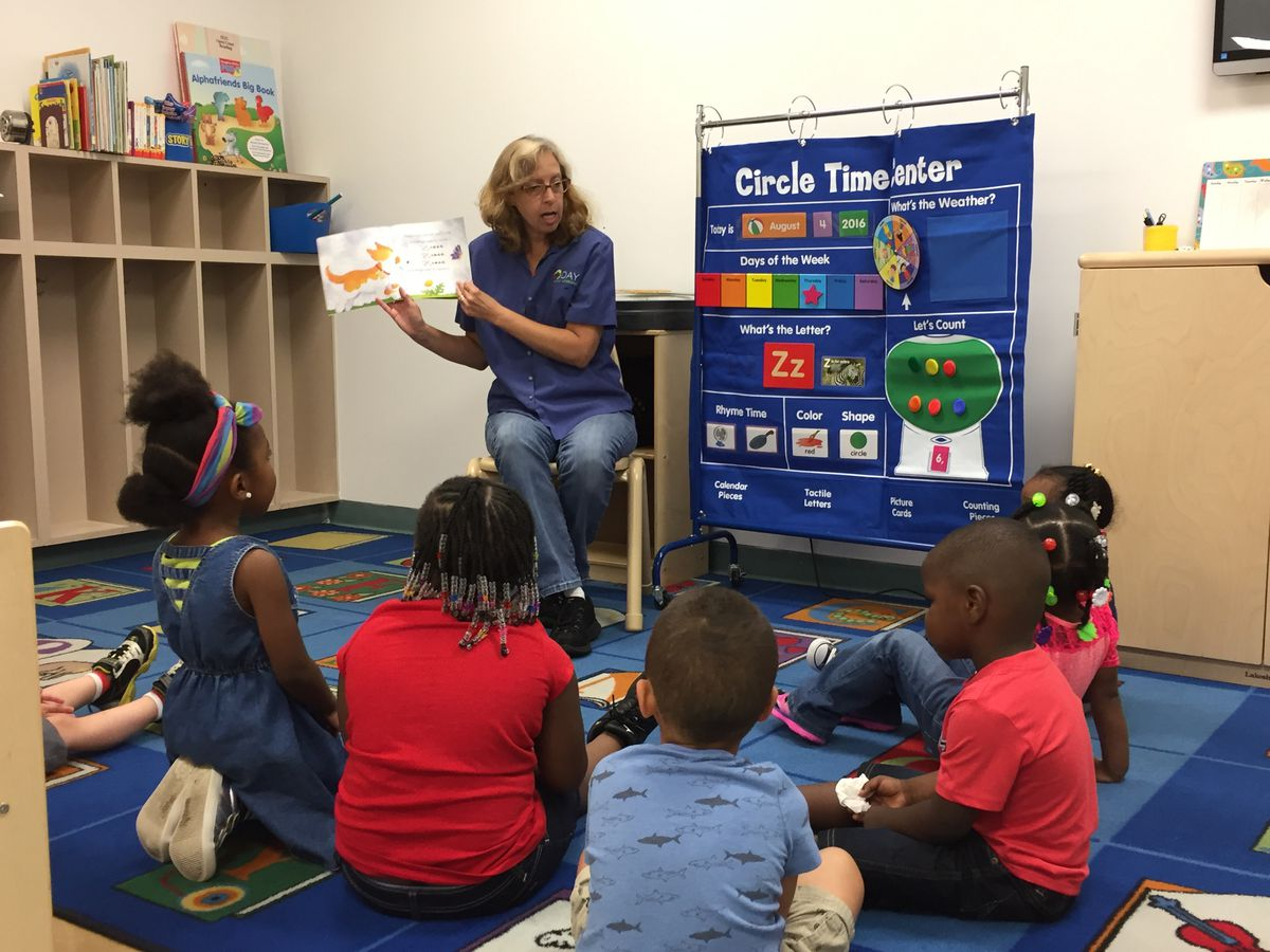 Teacher Norma Callahan reads a book to her preschool class during group time at Day Early Learning at Eastern Star Church.