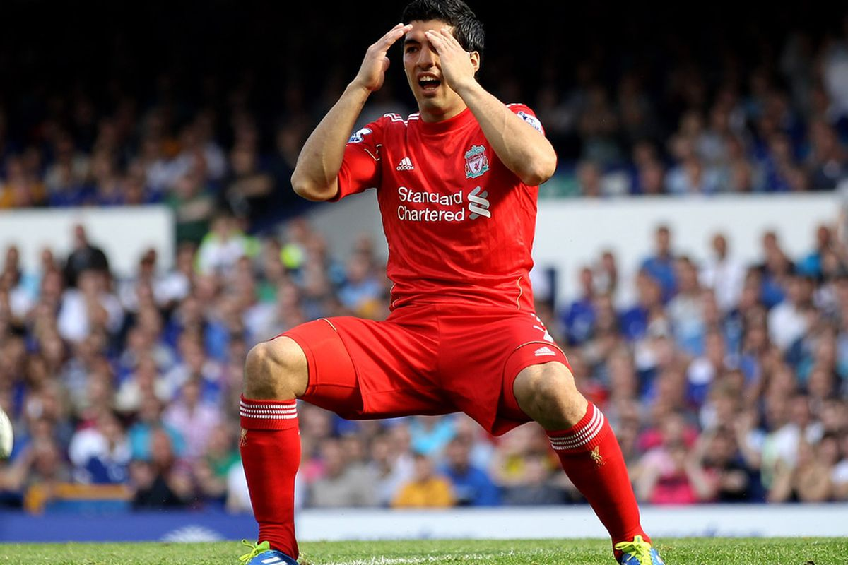 Luis Suarez of Liverpool reacts to a missed chance during the Barclays Premier League match between Everton and Liverpool at Goodison Park.