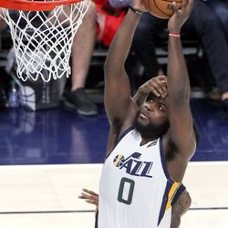 Utah Jazz forward Eric Paschall (0) shoots as New Orleans Pelicans guard Nickeil Alexander-Walker (6) guards him during a preseason NBA game at the Vivint Smart Home Arena in Salt Lake City on Monday, Oct. 11, 2021. The Jazz won 127-96.