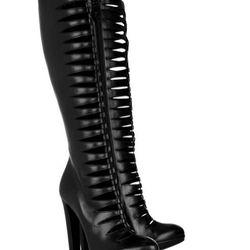 "<b>Alaïa</b> Peau leather cut-out boots, <a href=""http://www.theoutnet.com/product/220539"">$338</a> (were $2,250)."
