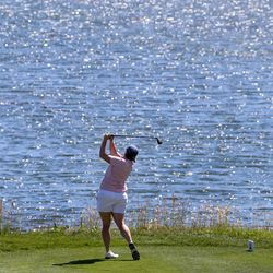 Kelsey Chugg drives the ball over a lake on the 18th hole during the Utah Women's State Amateur at the Soldier Hollow Golf Course in Midway on Wednesday, July 15, 2020. Chugg defeated Apelila Galeai after two extra holes to advance in the tournament.