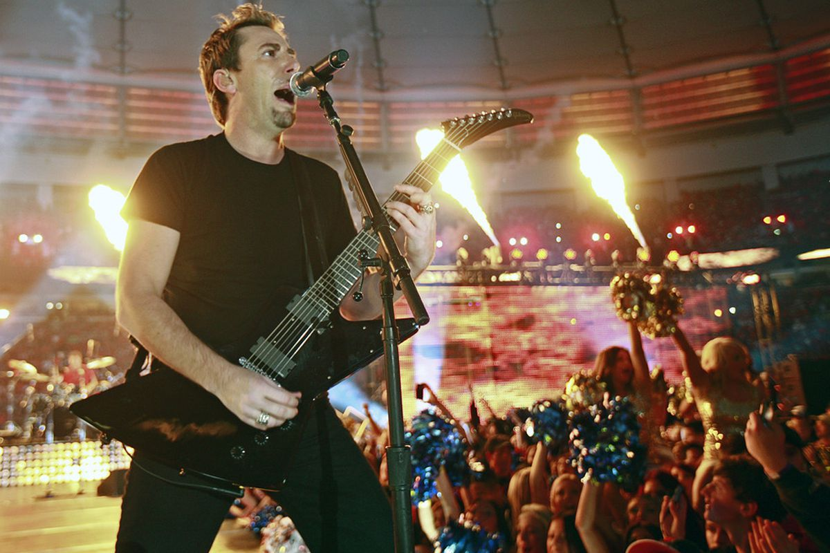 VANCOUVER, CANADA - NOVEMBER 27: Chad Kroeger, lead singer of Nickelback, performs during haltime of the  CFL 99th Grey Cup November 27, 2011 at BC Place in Vancouver, British Columbia, Canada. (Photo by Jeff Vinnick/Getty Images)