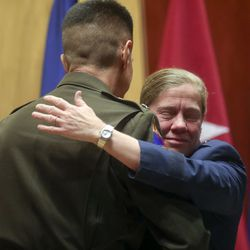 Utah Air National Guard Brig. Gen. Christine Burckle hugs Maj. Gen. Jefferson S. Burton, adjutant general of the Utah National Guard, after he awarded her the Legion of Merit, one of the highest peacetime U.S. military decorations, during her retirement ceremony at the Roland R. Wright Air National Guard Base in Salt Lake City on Thursday, Aug. 29, 2019.