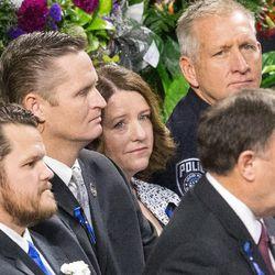 Erika Barney listens as Utah Gov. Garry Herbert speaks at funeral services for her husband, Unified police officer Doug Barney, at the Maverik Center in West Valley City on Monday, Jan. 25, 2016.