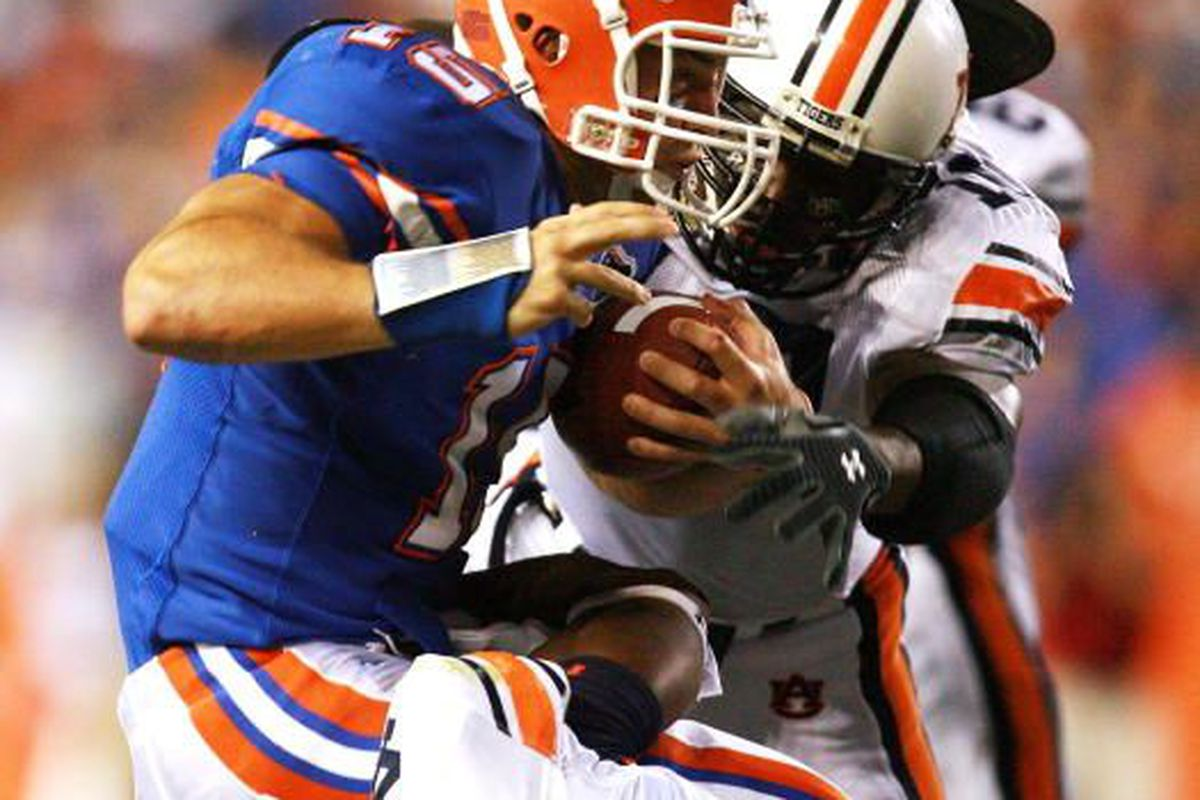 Auburn Linebackers Craig Sanders, No.46 and Tray Blackmon tackle Florida QB Tim Tebow September 29th, 2007 in Gainesville, Fla. Auburn won the game 20-17.