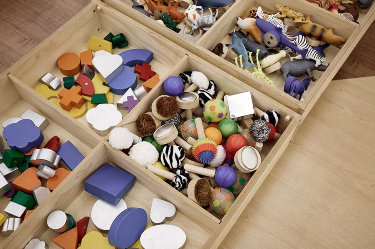 Colorful wall pegs in boxes