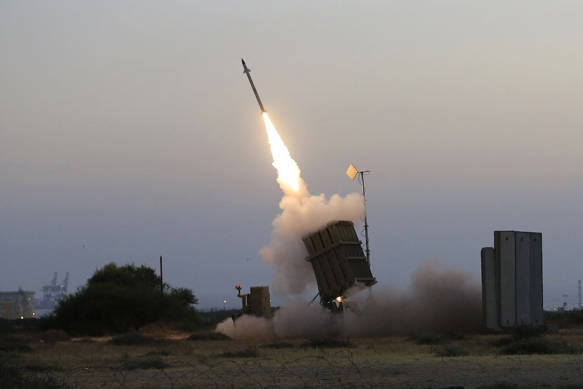 An Iron Dome missile defense system fires to intercept a rocket from Gaza