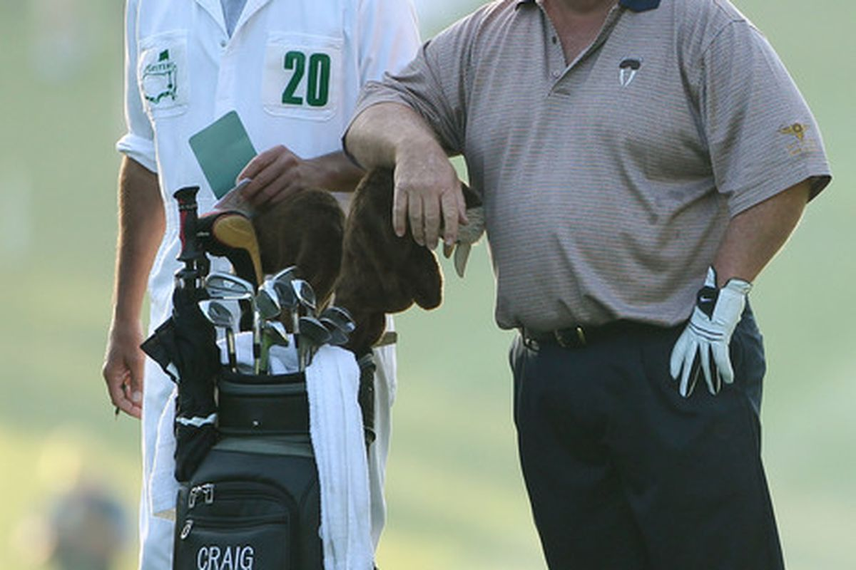 Craig Stadler (R) looks on from the first hole while alongside his caddie Jeff Dolf during the first round of the 2010 Masters Tournament at Augusta National Golf Club in Augusta, Georgia.  (Photo by Andrew Redington/Getty Images)