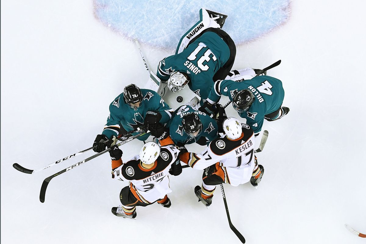 SAN JOSE, CA - APRIL 18: Goalie Martin Jones #31, Brenden Dillon #4, Logan Couture #39 and Dylan DeMelo #74 of the San Jose Sharks defend their goal against Nick Ritchie #37 and Ryan Kesler #17 of the Anaheim Ducks during the third period in Game Four of