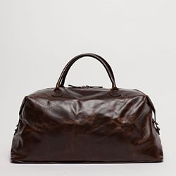 "<b>Moore & Giles</b> Benedict Weekender in Brompton Brown, <a href=""http://www.mooreandgiles.com/shop/benedict-weekend-bag-brompton-walnut-copy/"">$695</a>"