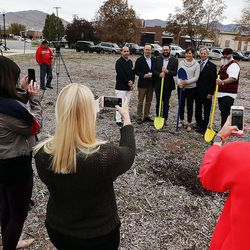 People take photos during a groundbreaking for the new Central Ninth Market in Salt Lake City, Wednesday, Oct. 28, 2015. The 9,216-square-foot commercial building will be occupied by six locally-owned small businesses, including Jade Market, which will stand as the first local food market in the neighborhood.