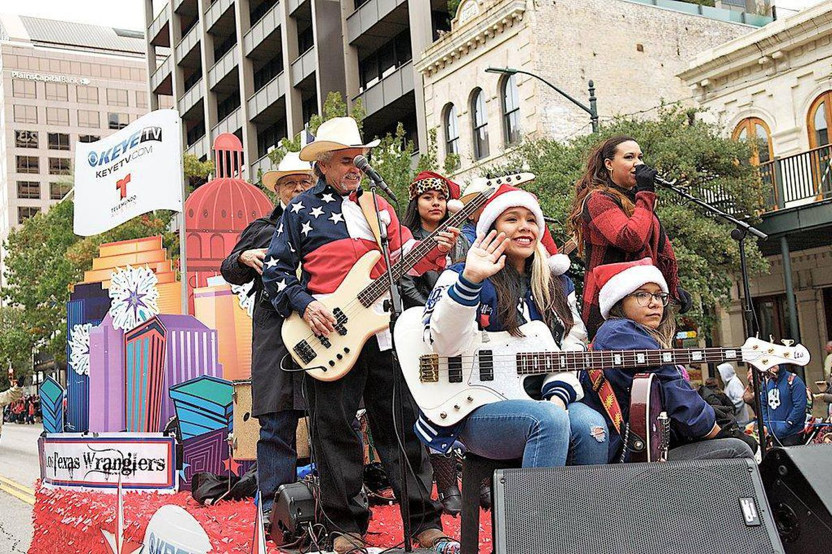 Adult musicians and kids on a float