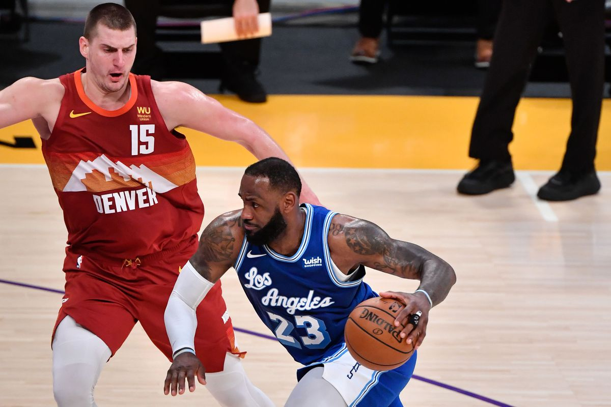 Los Angeles Lakers forward LeBron James drives to the basket on Denver Nuggets center Nikola Jokic during the second half at Staples Center.