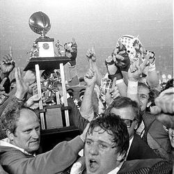 LaVell Edwards celebrates a win in the 1980 Holiday Bowl.  Kyle Whittingham in the foreground. BYU vs Southern Methodist in the 1980 Holiday Bowl.