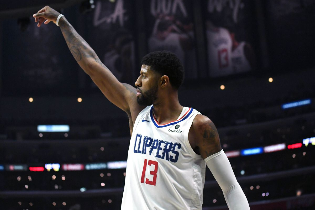 LA Clippers forward Paul George follows through on a three-point basket in the third quarter against the Phoenix Suns at Staples Center.The Clippers defeated the Suns 120-99.
