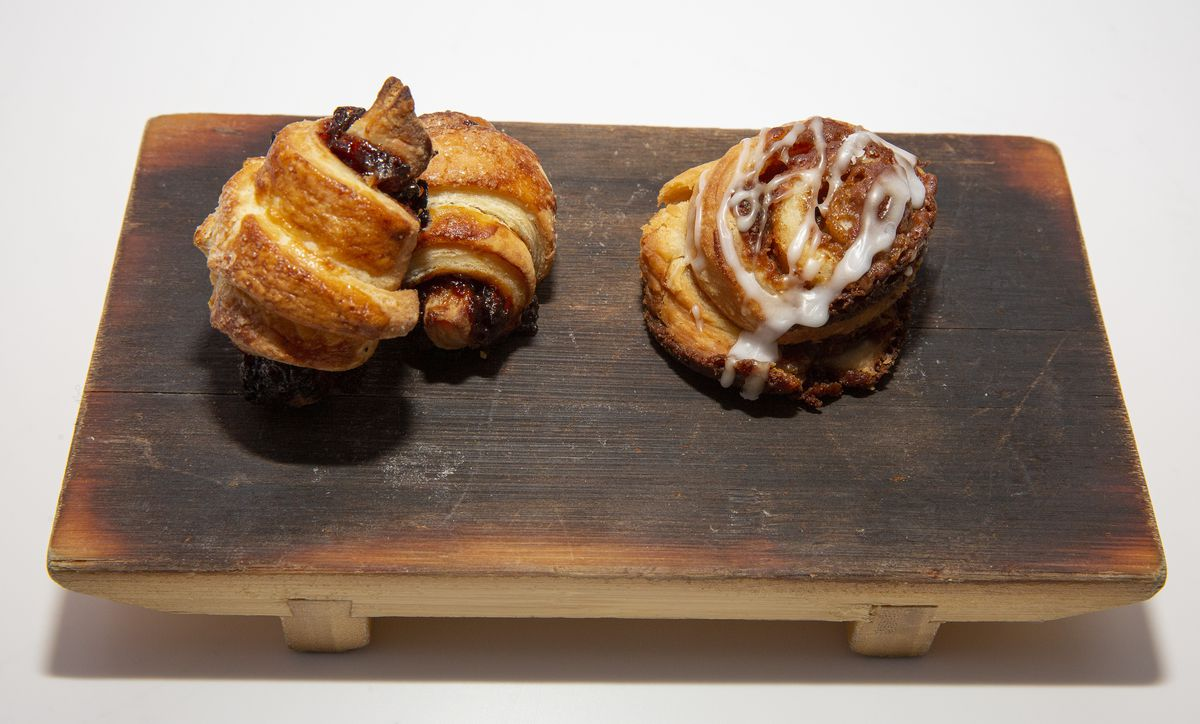 Rolled sweet pastries on a wooden plate