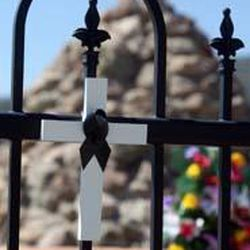 A cross representing one of the victims of the Mountain Meadows Massacre is placed on the fence during an event marking the 150th anniversary of the Mountain Meadows Massacre at the memorial site near Enterprise.