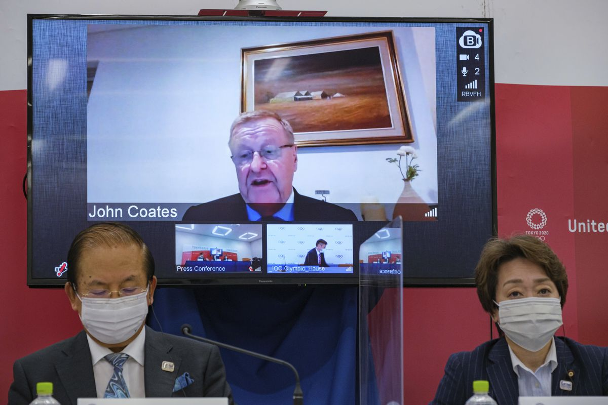 IOC vice president John Coates (on screen) expects the Tokyo Olympics to go on as planned regardless of the number of COVID-19 cases in Japan.