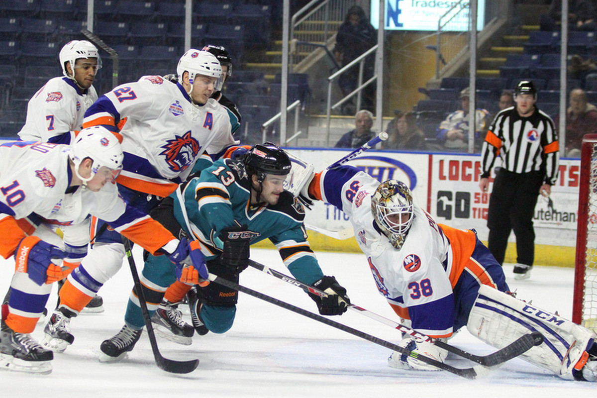 Worcester Sharks rookie forward Brock Higgs lifts a backhanded shot past Bridgeport Sound Tigers goaltender Kevin Poulin for his first professional goal in the first period Saturday night.