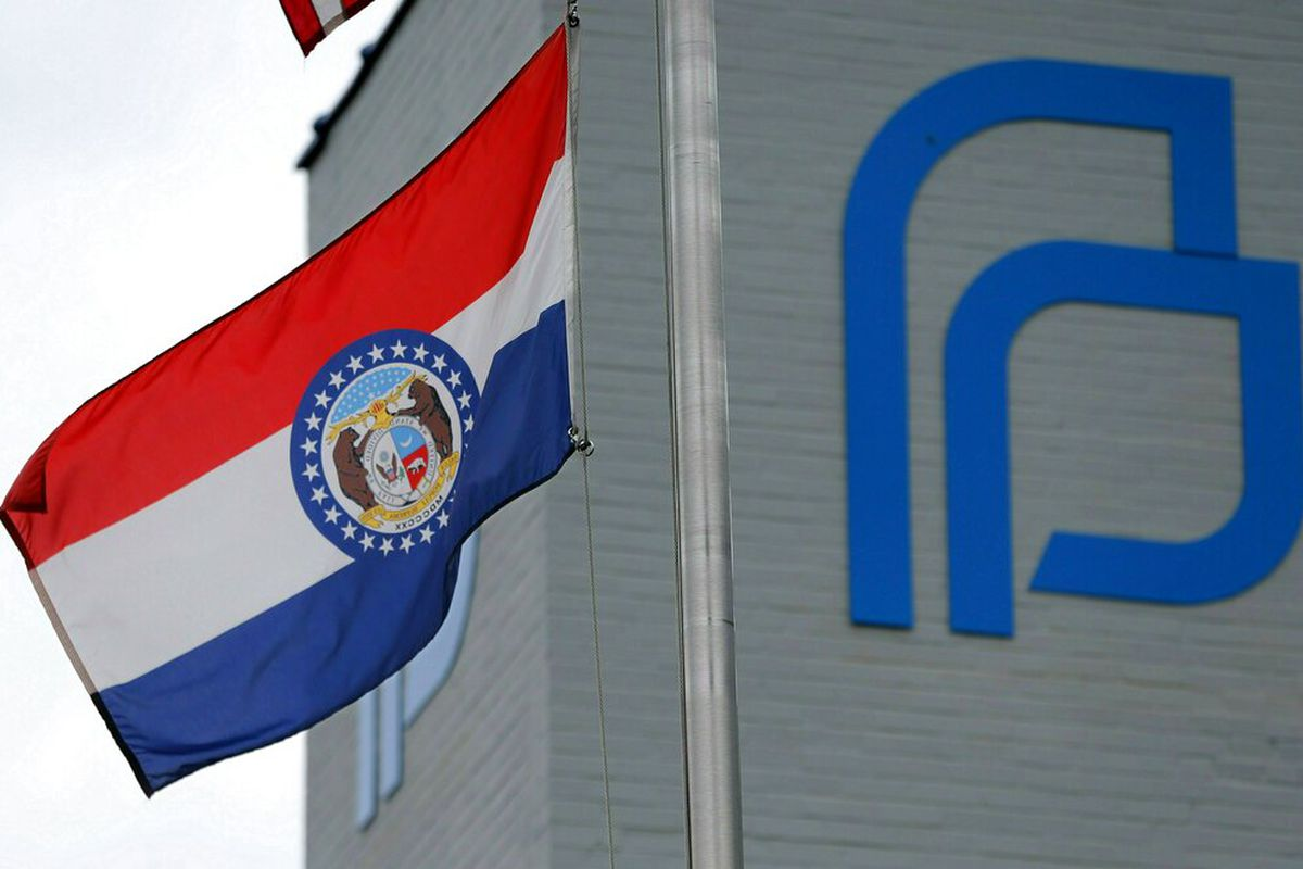 Outside of a Missouri Planned Parenthood with Missouri state flag