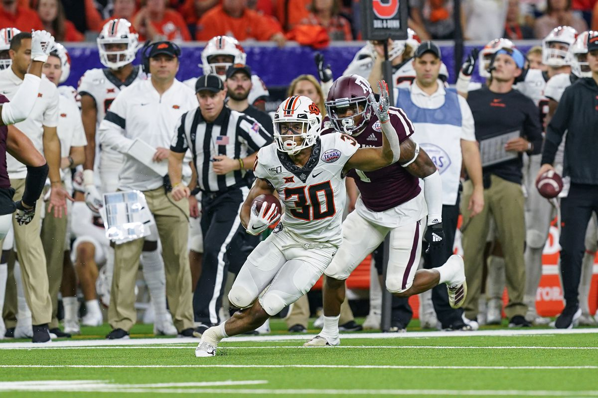 Oklahoma State Cowboys running back Chuba Hubbard runs the ball during the college football game between the Oklahoma State Cowboys and Texas A&M Aggies on December 27, 2019 at NRG Stadium in Houston, TX.