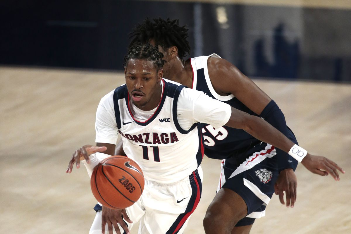 Joel Ayayi drives against Dominick Harris during a scrimmage of the Gonzaga Bulldogs in the Numerica Kraziness in The Kennel at McCarthy Athletic Center on November 12, 2020 in Spokane, Washington.