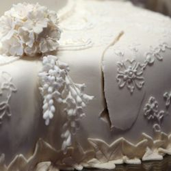 LONDON - JULY 20:  The first cut made by the Duke and Duchess of Cambridge in the royal wedding cake is photographed before it goes on display at Buckingham Palace during the annual summer opening on July 20, 2011 in London, England. The cake was featured