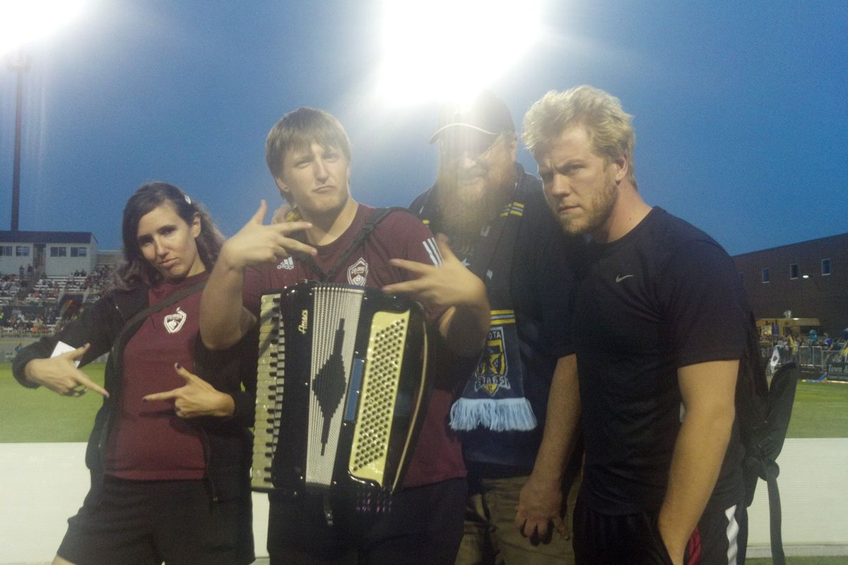Burgundy Wave Staff thugging it up with Bruce Mcguire from du Nord at the Minnesota Stars FC match against the San Antonio Scorpions.