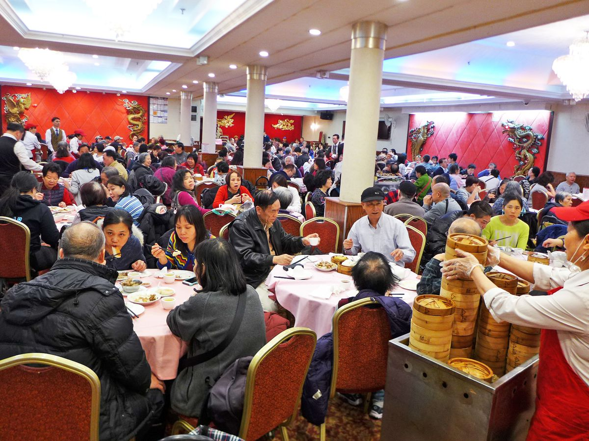 Royal Seafood's banquet-style dining room, with red chairs and dim sum carts, is packed with people