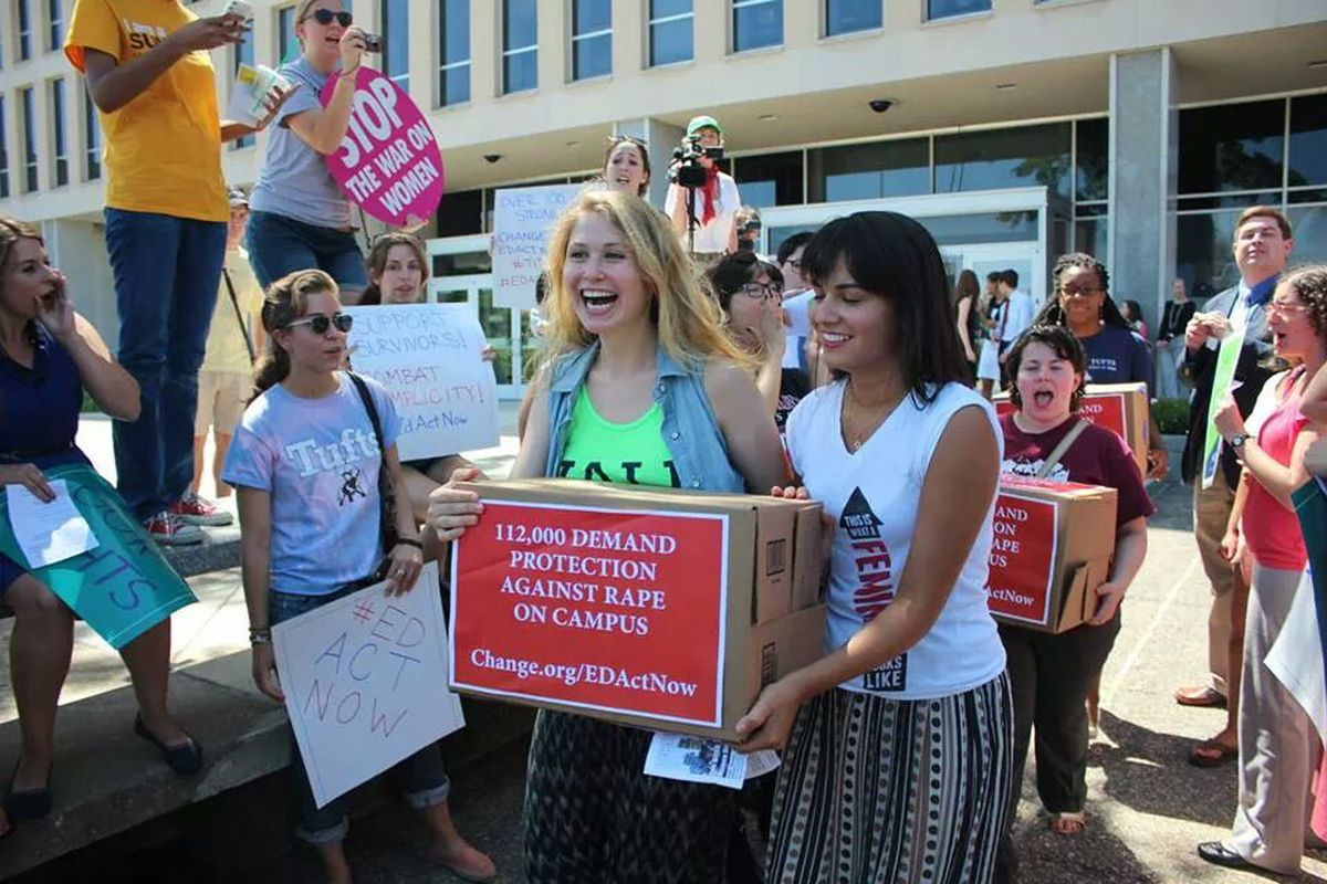 Know Your IX's Alexandra Brodsky (left) and Suzanna Bobadilla (right) carry a box of petitions calling for more serious enforcement of federal laws concerning sexual assault on campus during a protest outside the Department of Education.
