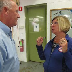Republican U.S. Senate candidate Pete Hoekstra talks with Debora Weir, an employee of Traverse Bay Manufacturing Inc., as he tours the textile products factory in Elk Rapids, Mich., Sept. 24, 2012.
