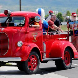 Organizers of the Sounds of Freedom Festival pull into Fire Station No. 51 in Layton to deliver Little Caesars pizzas to first responders on Friday, May 15, 2020. Festival organizers dropped off pizzas at the Davis County Sheriff's Office, the Farmington Fire Department, and the Layton and Clearfield fire departments while driving in a restored 1939 firetruck that was used at Kennecott Copper in the '40s and restored for Shriner's Hospital for Children.
