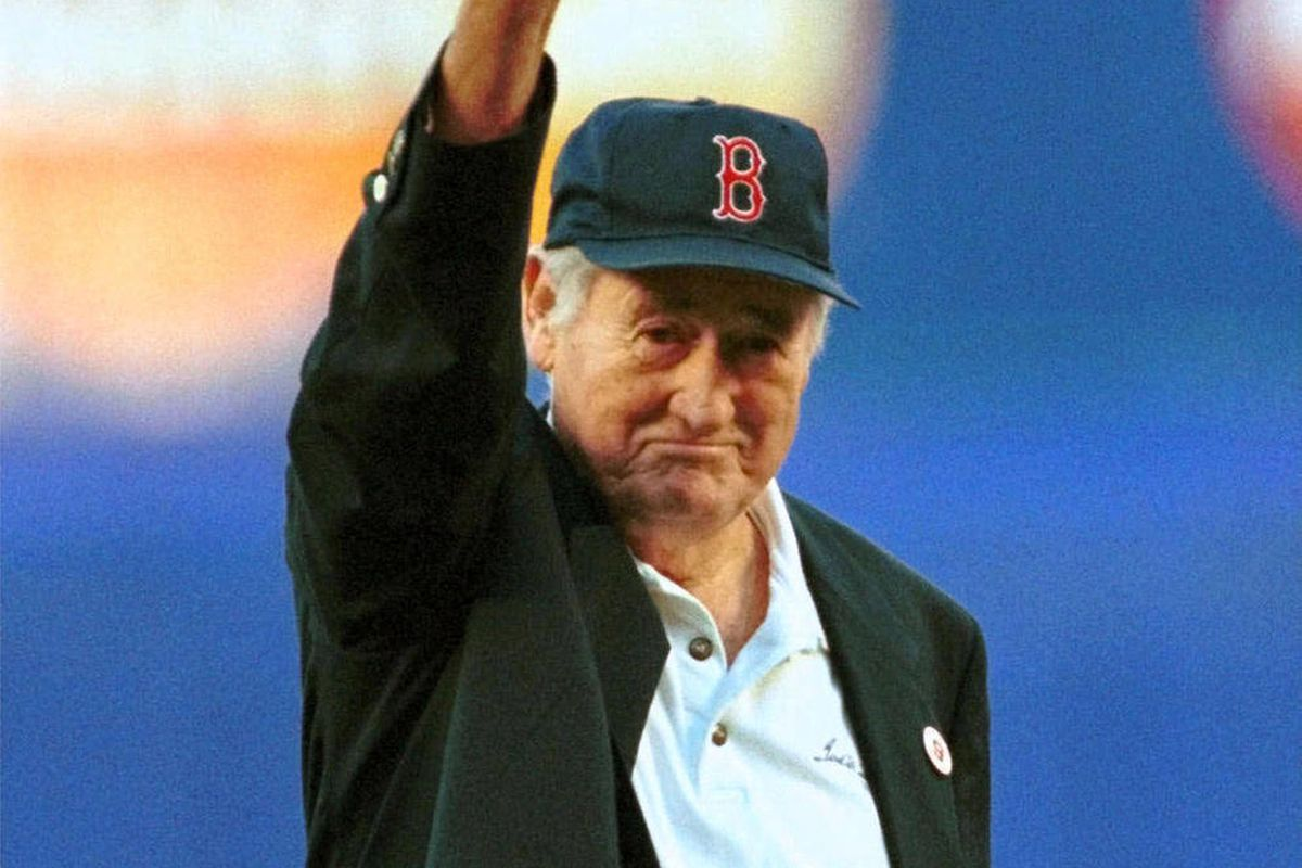 FILE - In this June 11, 1999, file photo, Boston Red Sox Hall of Famer Ted Williams winds up to throw out the ceremonial first pitch before a baseball game between the Red Sox game and the New York Mets in New York. Fans can see hundreds of items once own