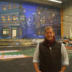"""Adam Sklute, Artistic Director at Ballet West since 2007, poses for a photo in front of a new set for """"The Nutcracker."""""""