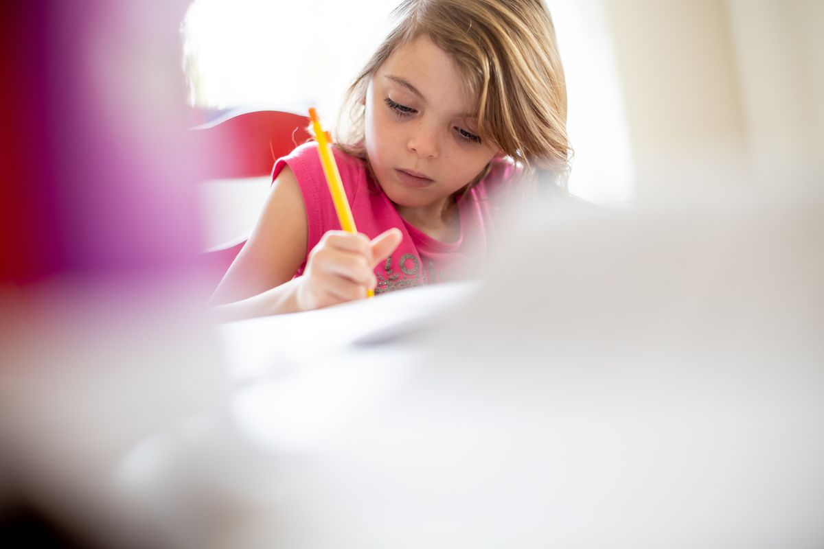 Vivian Seger, 6, does schoolwork at her home in South Jordan on Thursday, Oct. 7, 2021.