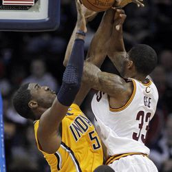 Indiana Pacers' Roy Hibbert, left, blocks a shot by Cleveland Cavaliers' Alonzo Gee in the first quarter of an NBA basketball game Wednesday, April 11, 2012, in Cleveland.