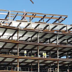 10:55 a.m. Workers on various levels of plaza building -