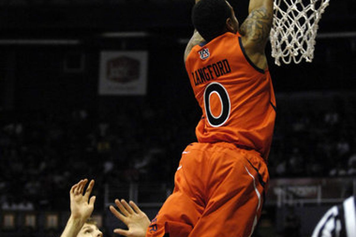 Auburn forward Josh Langford dunks the ball against Hawaii Dec. 23, 2011. Langford was one of two players dismissed from the team Friday by Head Coach Tony Barbee. (<em>photo,Todd Van Ernst</em>)